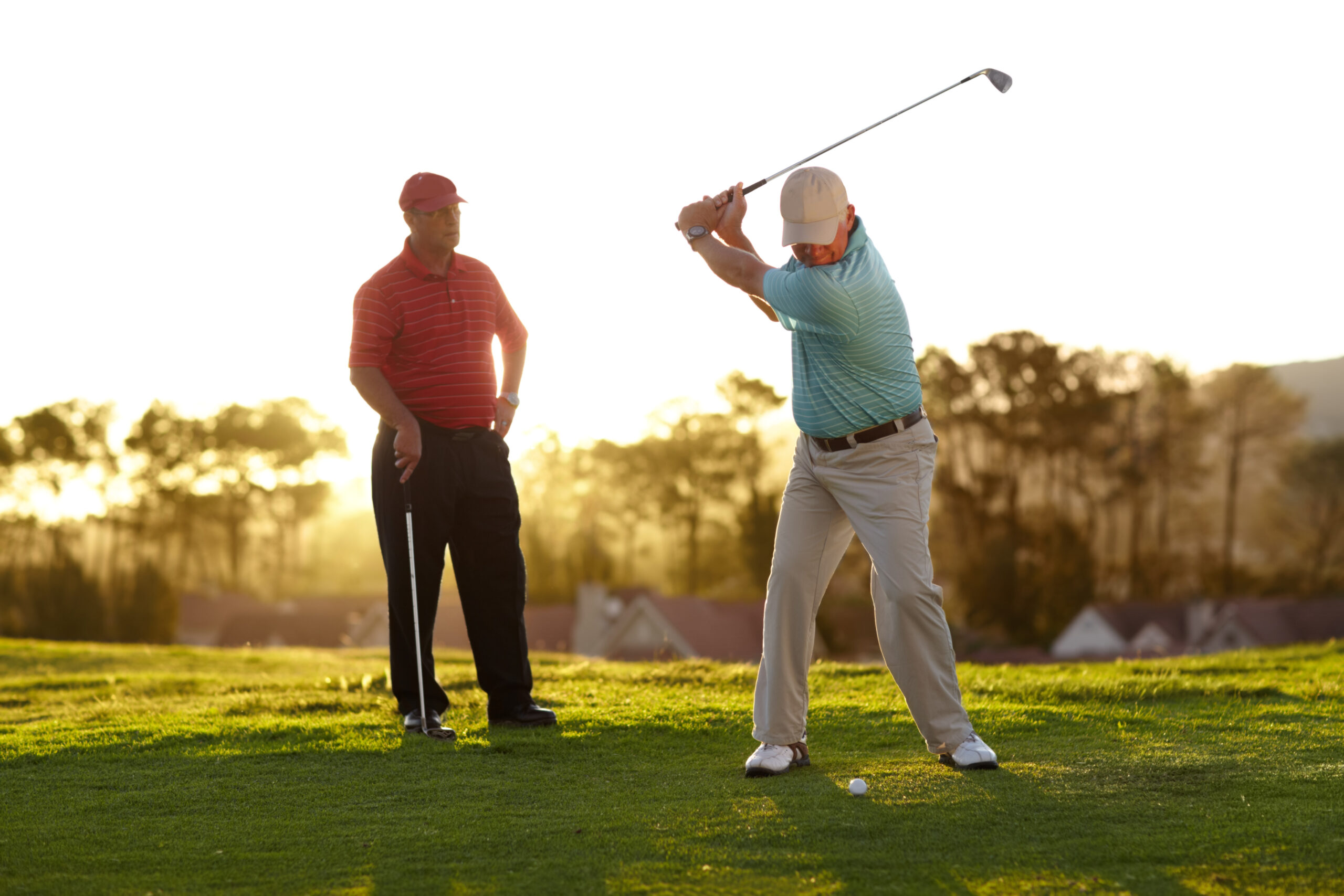 Two male golfers going through a round of golf